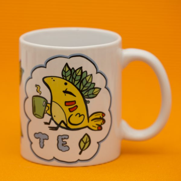 Tea mug with colourful creative illustration of a bird and handwritten typography on orange background